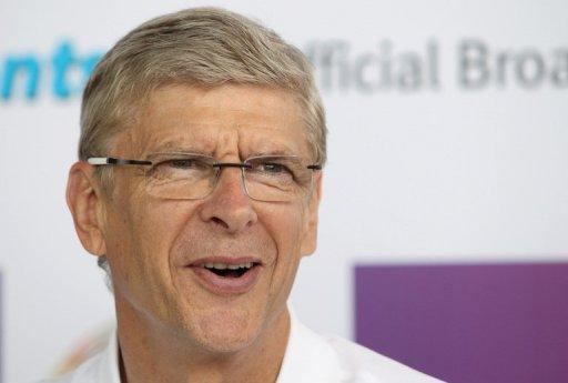 "Arsene Wenger, manager of English premier league football team Arsenal, smiles during a press conference in Hong Kong on July 28. He has denied speculation that Arsenal were about to buy Spanish winger Santi Cazorla, saying the club were ""not close to signing anybody"""