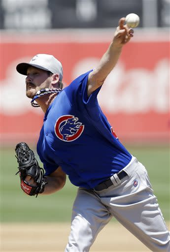 Chicago Cubs starting pitcher Travis Wood throws to the Oakland Athletics during the third inning of a baseball game on Thursday, July 4, 2013, in Oakland, Calif. (AP Photo/Marcio Jose Sanchez)