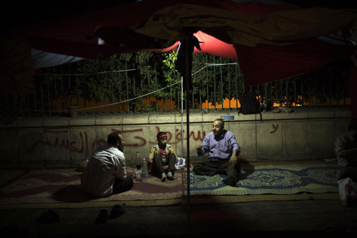 Supporters of Egypt's ousted President Mohammed Morsi ist in a tent a protest against the Egyptian Army near Cairo University in Giza, Egypt, Monday, Aug. 5, 2013. More than a month after Morsi's ouster, thousands of the Islamist leader's supporters remain camped out in two key squares in Cairo demanding his reinstatement. Egypt's military-backed interim leadership has issued a string of warnings for them to disperse or security forces will move in, setting the stage for a potential violent showdown. (AP Photo/Manu Brabo)