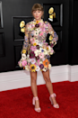 <p>After a few years off, Taylor attended this year's Grammys wearing an embellished floral mini dress by Oscar De La Renta.</p>
