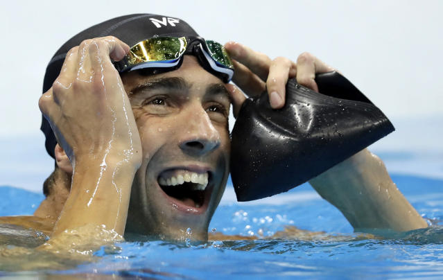 "FILE - In this Aug. 12, 2016, file photo, United States' swimmer Michael Phelps reacts after the men's 100-meter butterfly final at the 2016 Summer Olympics in Rio de Janeiro, Brazil. Phelps is picking up more hardware _ this time for what he's been doing outside the pool. The Boston-based Ruderman Family Foundation, a leading voice in calling for more opportunities for the disabled, says the Olympic champion is the recipient of its fifth annual Morton E. Ruderman Award in Inclusion. The foundation tells The Associated Press it picked the world's most-decorated swimmer of all time to recognize his advocacy for people with disabilities and ""his own journey with mental health."" (AP Photo/Michael Sohn, File)"