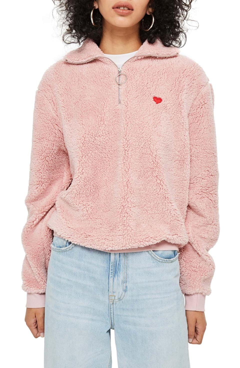 "<p><strong>Topshop</strong></p><p>nordstrom.com</p><p><strong>$50.00</strong></p><p><a href=""https://shop.nordstrom.com/s/topshop-borg-heart-quarter-zip-pullover/5101322"" rel=""nofollow noopener"" target=""_blank"" data-ylk=""slk:SHOP NOW"" class=""link rapid-noclick-resp"">SHOP NOW</a></p><p>She'll live in this cozy fleece pullover <a href=""https://www.womansday.com/life/g25396453/best-heated-products-for-winter/"" rel=""nofollow noopener"" target=""_blank"" data-ylk=""slk:all winter long"" class=""link rapid-noclick-resp"">all winter long</a> - and she'll think about you every time she slips it on.</p>"