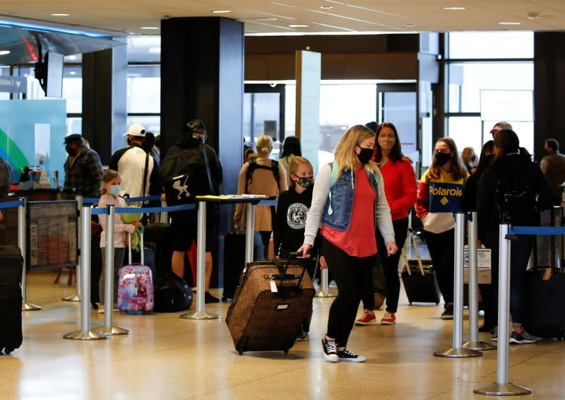 Travelers at Seattle-Tacoma International Airport in SeaTac