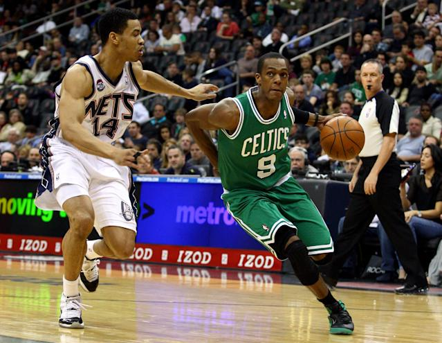NEWARK, NJ - APRIL 14: Rajon Rondo #9 of the Boston Celtics drives in the first half against Gerald Green #14 of the New Jersey Nets at Prudential Center on April 14, 2012 in Newark, New Jersey. NOTE TO USER: User expressly acknowledges and agrees that, by downloading and or using this photograph, User is consenting to the terms and conditions of the Getty Images License Agreement. (Photo by Chris Chambers/Getty Images)