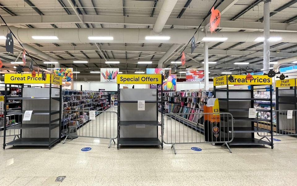 Non-essential items are sealed off in a Tesco store in Pengam Green - Getty Images Europe