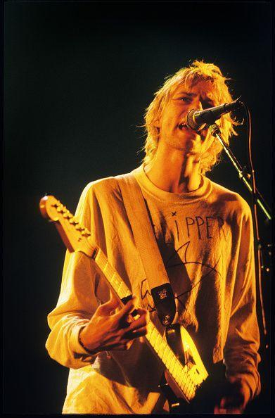 <p>Kurt Cobain performing in Paris, France in 1992. After several global tour stops and a pair of EPs, Nirvana released their third studio album, <em>In Utero, </em>in 1993, which garnered more critical and commercial acclaim.</p>