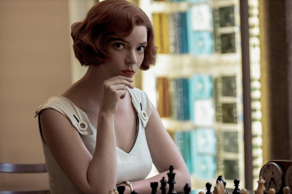"""<p>All you need to be the young chess prodigy for <a class=""""link rapid-noclick-resp"""" href=""""https://www.popsugar.co.uk/Halloween"""" rel=""""nofollow noopener"""" target=""""_blank"""" data-ylk=""""slk:Halloween"""">Halloween</a> is a red wig styled in a short, curled bob. This hairstyle has become synonymous with Beth and will have people saying """"checkmate"""" to you instantly. When it comes to the character's makeup, chances are that what you already have in your collection of beauty products should do. She stayed true to the '50s and '60s with her berry-red lipstick, dramatic black winged eyeliner, and natural brows.</p>"""