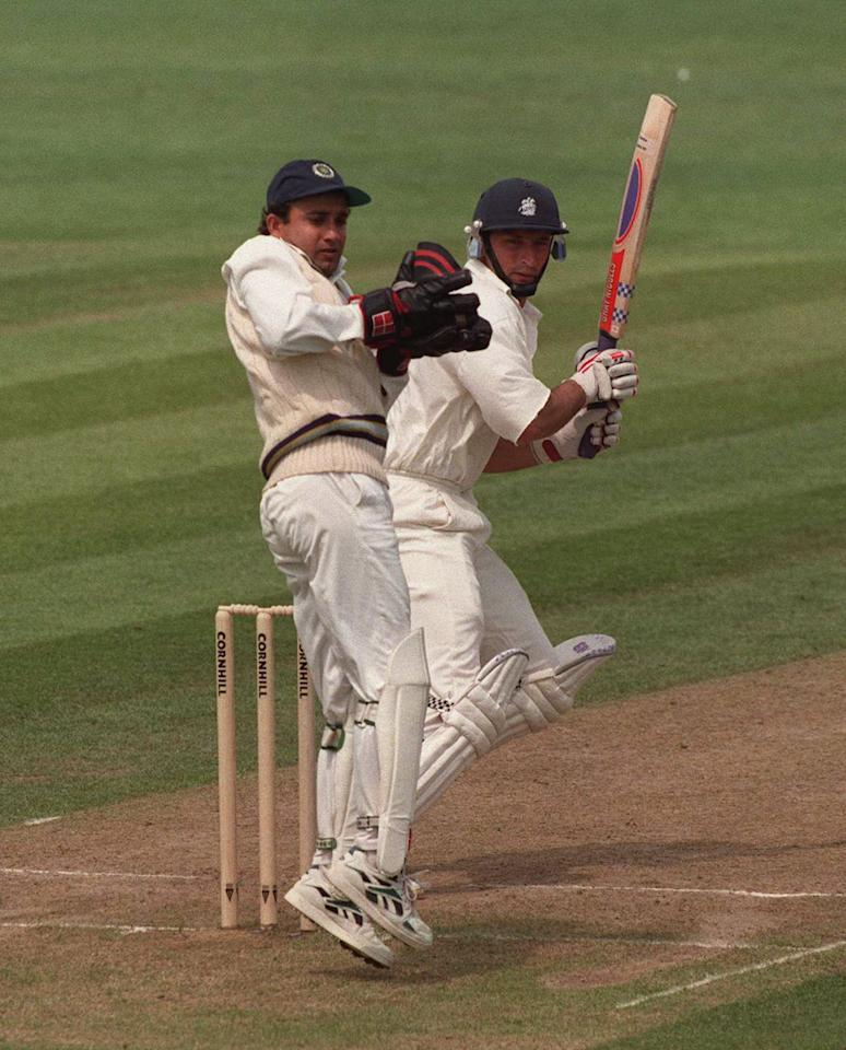7 June 1996:  England batsman Nasser Hussain on his way to his maiden Test century as Mongia looks on during the second days play in the First England v India Cornhill Test Match at Edgbaston. Mandatory Credit: Adrian Murrell/ALLSPORT
