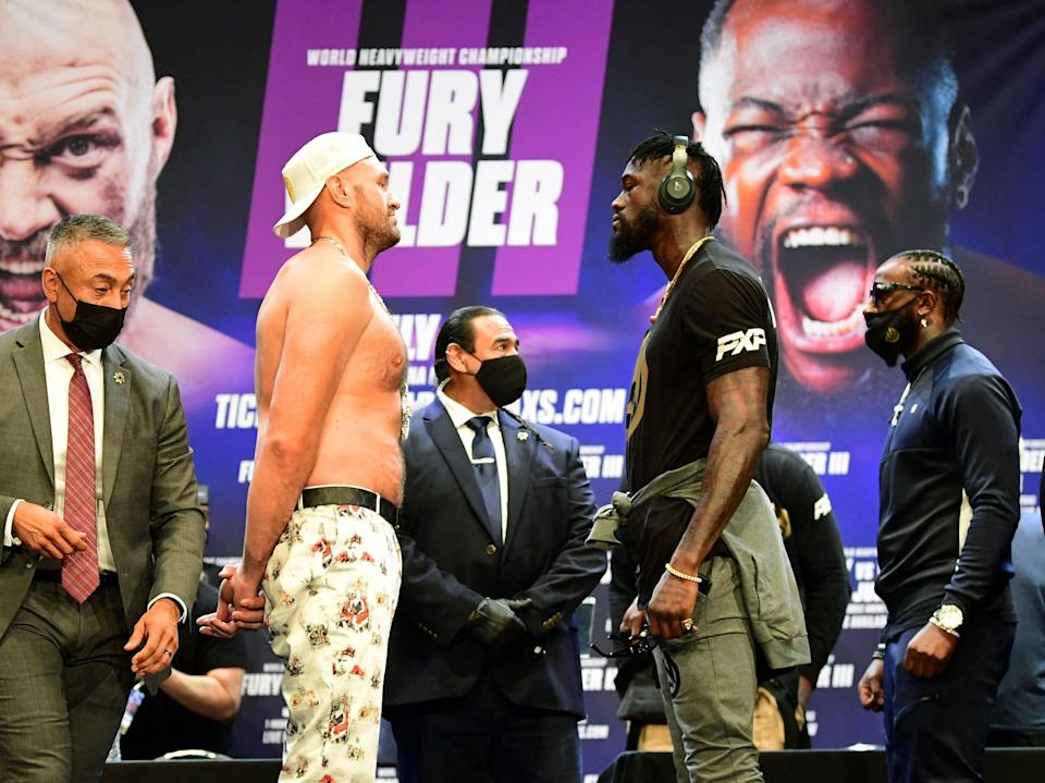 Fury and Wilder face off on 15 June at a Los Angeles press conference to announce their third WBC heavyweight championship fight, scheduled for 24 July in Las Vegas (AFP/Getty)