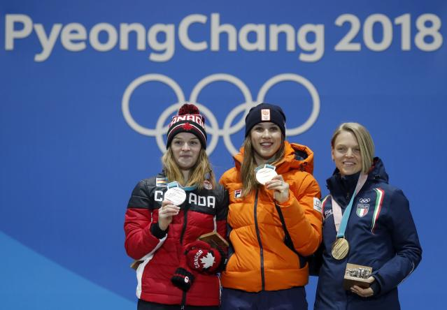 Medals Ceremony - Short Track Speed Skating Events - Pyeongchang 2018 Winter Olympics - Women's 1000m - Medals Plaza - Pyeongchang, South Korea - February 23, 2018 - Gold medalist Suzanne Schulting of the Netherlands, silver medalist Kim Boutin of Canada and bronze medalist Arianna Fontana of Italy on the podium. REUTERS/Eric Gaillard