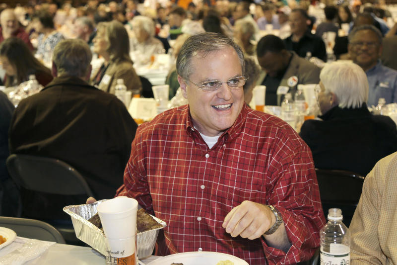 In this Saturday, Jan. 11, 2014 photo, U.S. Sen. Mark Pryor, D-Ark., holds a pan of raccoon meat at the Gillett Coon Supper in Gillett, Ark. Pryor faces a challenge from Republican Tom Cotton in the 2014 election. (AP Photo/Danny Johnston)