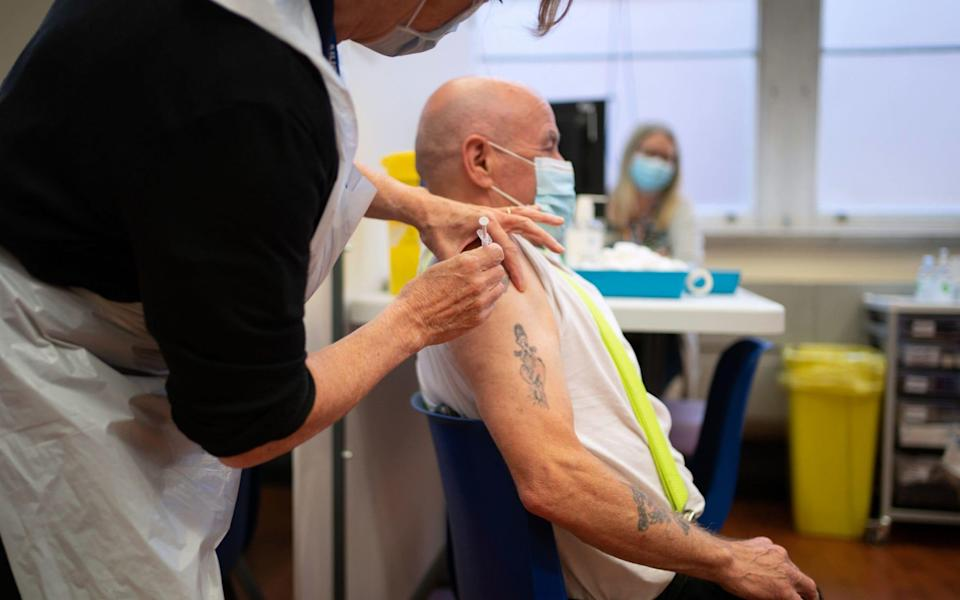 A man receives a Covid-19 booster vaccine at Midland House in Derby on 20 September 2021 - Joe Giddens/PA