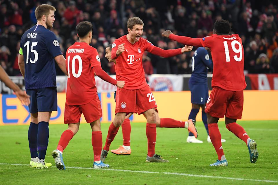 MUNICH, GERMANY - DECEMBER 11: Thomas Muller of FC Bayern Munich (C) celebrates after scoring his team's second goal with Alphonso Davies during the UEFA Champions League group B match between Bayern Muenchen and Tottenham Hotspur at Allianz Arena on December 11, 2019 in Munich, Germany. (Photo by Michael Regan/Getty Images)