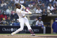 San Diego Padres' Fernando Tatis Jr. hits a double in the second inning of the team's baseball game against the New York Mets on Saturday, June 5, 2021, in San Diego. (AP Photo/Derrick Tuskan)
