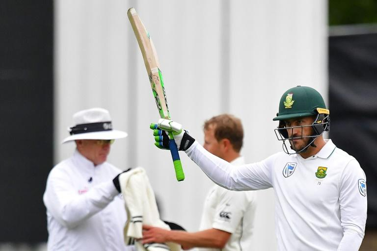 South Africa's captain Faf du Plessis celebrates 50 runs on day four of their first Test match against New Zealand, at the University Oval in Dunedin, on March 11, 2017