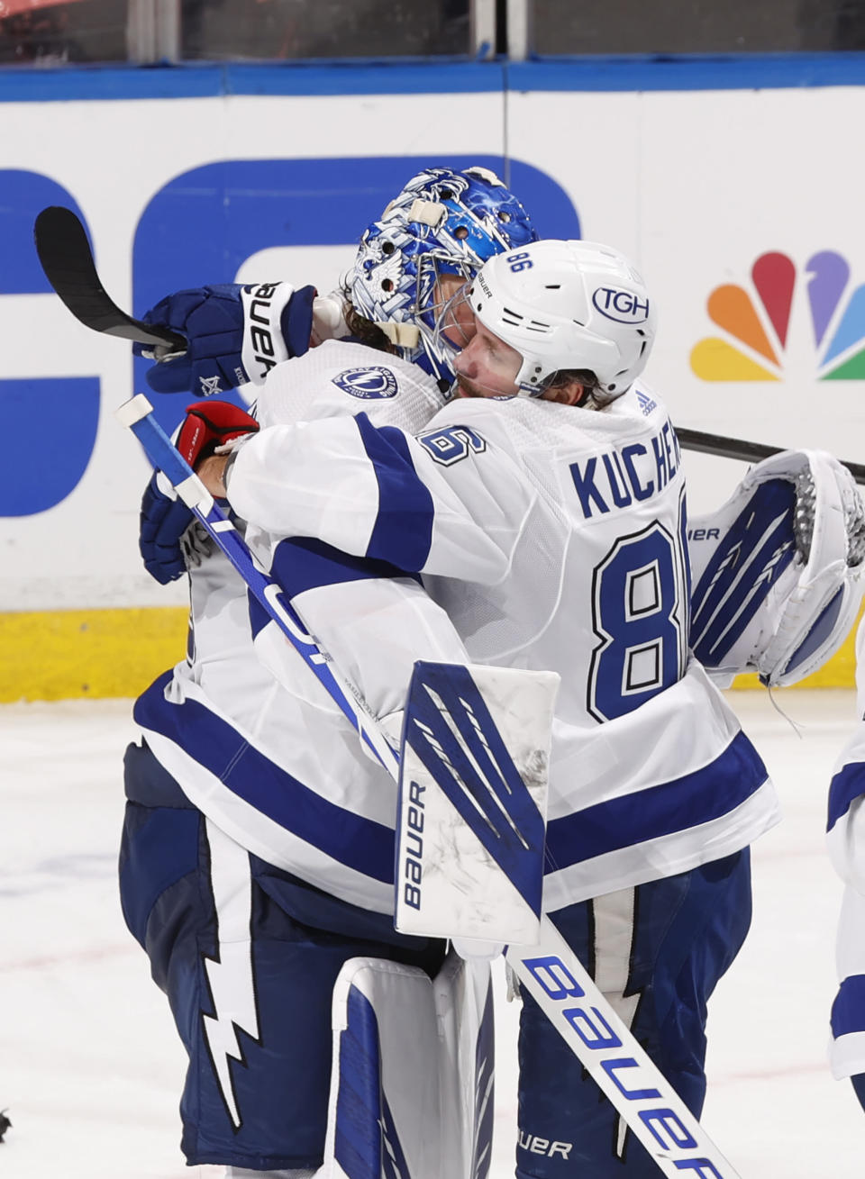 Tampa Bay Lightning goaltender Andrei Vasilevskiy (88) celebrates the win with Tampa Bay Lightning right wing Nikita Kucherov (86) against the Florida Panthers after the third period in Game 1 of an NHL hockey Stanley Cup first-round playoff series, Sunday, May 16, 2021, in Sunrise, Fla. (AP Photo/Joel Auerbach)