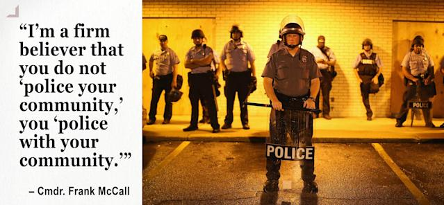 Police stand guard before the mandatory midnight curfew in Ferguson (Photo: Scott Olson/Getty Images)