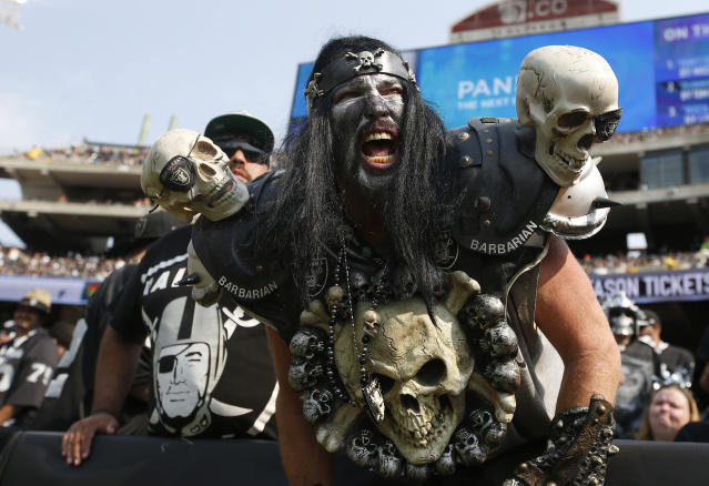 """FILE - In this Sept. 13, 2015, file photo, Oakland Raiders fans watch during the second half of an NFL football game between the Oakland Raiders and the Cincinnati Bengals in Oakland, Calif. The south end zone sections, called The Black Hole, of Oakland-Alameda County Coliseum are known to have some of the rowdiest fans in American sports, face painters who dress up in evil costumes, often with spike-covered shoulder pads. The slow, agonizing demise of the Oakland Raiders will continue for at least one more season. There will be one more """"final"""" home game at the Oakland Coliseum, Dec. 15 against the Jacksonville Jaguars. There have been possible """"final"""" home games for a few years now because the Raiders have essentially had one foot out the door since 2015, when they joined with the AFC West rival Chargers in a failed attempt to build a stadium in the Los Angeles suburb of Carson. (AP Photo/Tony Avelar, File)"""