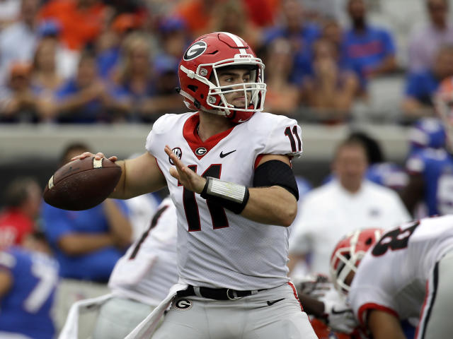 Georgia quarterback Jake Fromm throws a pass against Florida in the first half of an NCAA college football game, Saturday, Oct. 28, 2017, in Jacksonville, Fla. (AP Photo/John Raoux)