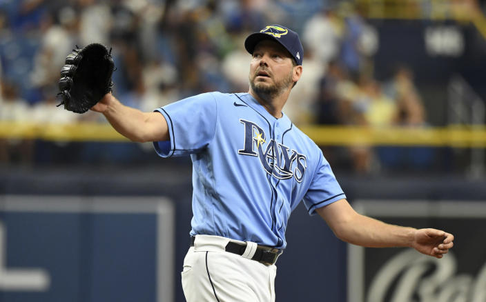 Tampa Bay Rays starter Rich Hill reaches for a new baseball after Toronto Blue Jays' Danny Jansen hit a solo home run during the third inning of a baseball game Sunday, July 11, 2021, in St. Petersburg, Fla.(AP Photo/Steve Nesius)
