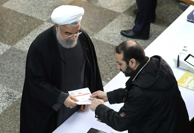 Iran's moderate conservative President Hassan Rouhani won re-election in 2017 promising more freedoms and the benefits of engagement with the West but now faces losing control of parliament to more conservative opponents (AFP Photo/-)