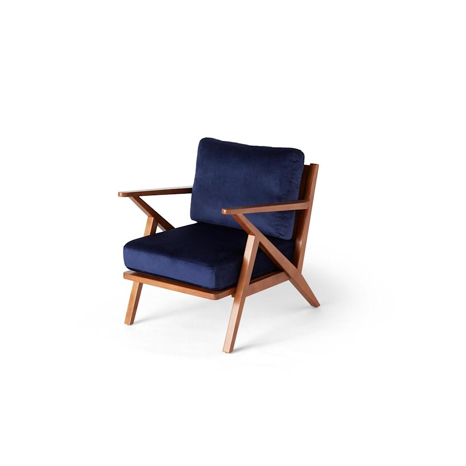 <p>We'll park ourselves in this <span>Drew Barrymore Flower Home Mid-Century Accent Chair</span> ($299). </p>