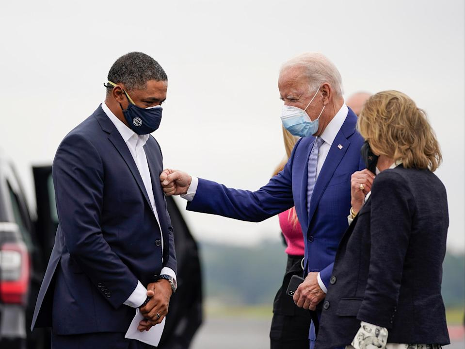 Cedric Richmond (D-LA) and Democratic presidential nominee Joe Biden greet each other as Biden arrives at Columbus Airport on 27 October 2020 in Columbus, Georgia ((Getty Images))