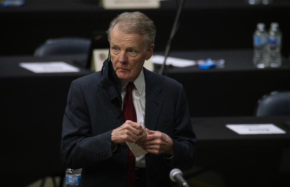 """FILE - In this Jan. 8, 2021, file photo, Illinois House Speaker Michael Madigan appears on the floor as the Illinois House of Representatives convenes at the Bank of Springfield Center, in Springfield, Ill. House Speaker Madigan on Monday, Jan. 11, 2021, said he was """"suspending"""" his campaign for a 19th term in the leadership post. Madigan, the longest-serving leader of a legislative body in U.S. history, issued a statement that began, """"This is not a withdrawal."""" But it urged House Democrats to """"work to find someone, other than me, to get 60 votes for speaker."""" (E. Jason Wambsgans/Chicago Tribune via AP File)"""