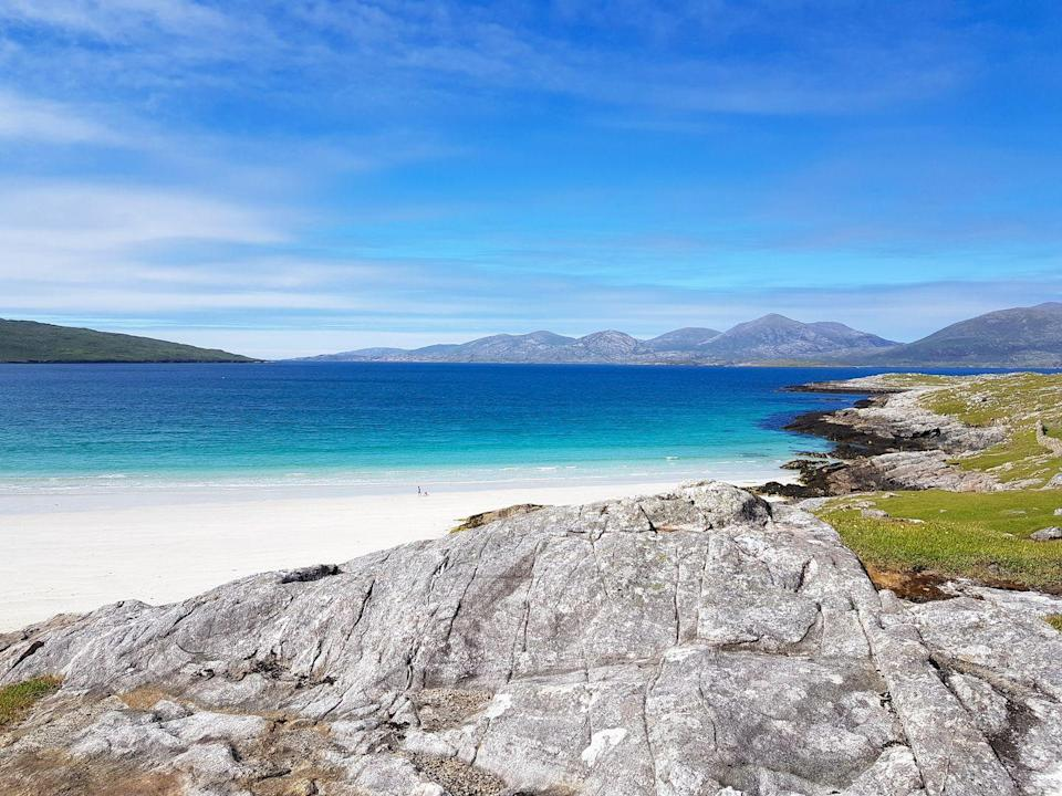 """<p>Lewis and Harris are two real Scottish heritage islands. You'll still hear Gaelic spoken on the streets of <a href=""""https://www.goodhousekeepingholidays.com/tours/uk-scotland-west-coast-tradewind-cruise"""" rel=""""nofollow noopener"""" target=""""_blank"""" data-ylk=""""slk:Stornoway"""" class=""""link rapid-noclick-resp"""">Stornoway</a>, the island's main town, and you can browse hand-woven Harris tweed clothing in the shops - perhaps what the area is most famous for. </p><p>Archaeology buffs will love the mysterious Neolithic landing stones at Callanish, which are even older than Stonehenge, and at the ancient blackhouse villages you can experience the unique Gaelic farming system of crofting.</p><p><strong>You can visit Lewis during a cruise along the west coast of Scotland.</strong></p><p><a class=""""link rapid-noclick-resp"""" href=""""https://www.goodhousekeepingholidays.com/tours/uk-scotland-west-coast-tradewind-cruise"""" rel=""""nofollow noopener"""" target=""""_blank"""" data-ylk=""""slk:FIND OUT MORE"""">FIND OUT MORE</a></p>"""