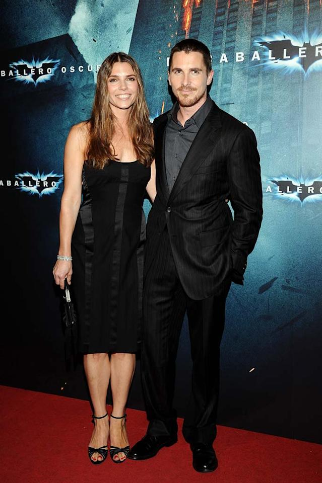 """Christian Bale should have been flying high after """"The Dark Knight's"""" record-breaking opening, but instead found himself behind bars after his sister and mother alleged he assaulted them. After being questioned and released by London police, Christian was joined by his wife Sibi at the Barcelona premiere of the Batman sequel on Wednesday. Carlos Alvarez/<a href=""""http://www.wireimage.com"""" target=""""new"""">WireImage.com</a> - July 24, 2008"""