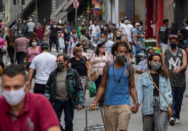 PHOTO: People walk through a downtown shopping district in Sao Paulo, Brazil, on June 10, 2020. (Andre Penner/AP)