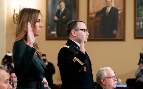 Jennifer Williams and Lt Col Alexander Vindman were sworn in on Capitol Hill on Tuesday - Credit: MICHAEL REYNOLDS/EPA-EFE/REX