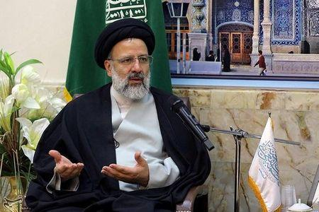 FILE PHOTO: Iranian senior cleric Ebrahim Raisis gestures as he meets grand clerics in the holy city of Qom