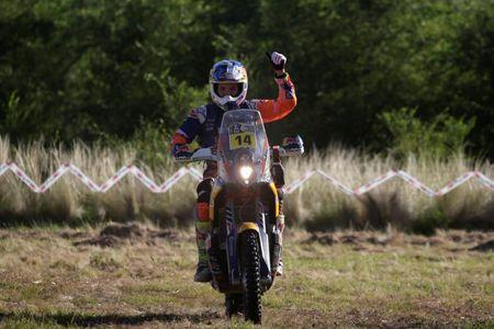 Dakar Rally - 2017 Paraguay-Bolivia-Argentina Dakar rally - 39th Dakar Edition - Twelfth stage from Rio Cuarto to Buenos Aires, Argentina - 14/01/17 - Sam Sunderland of Britain celebrates after finishing the special stage riding his KTM. REUTERS/Ricardo Moraes