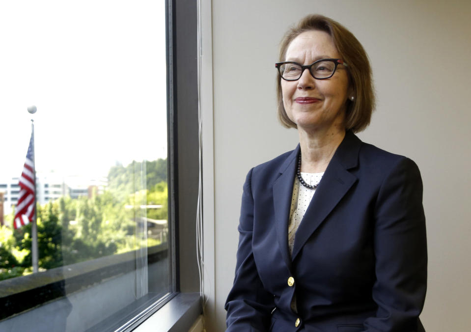 """FILE - In this July 13, 2016 file photo, Oregon Attorney General Ellen Rosenblum poses for a photo at her office in Portland, Ore. Oregon's attorney general is telling the U.S. Supreme Court that Oregon's criminal justice system would be """"overwhelmed"""" if the nation's highest court rules that nonunanimous jury verdicts are unconstitutional. If the U.S. Supreme Court finds nonunanimous juries unconstitutional, Rosenblum said in a brief filed Friday, Aug. 23, 2019, it could invalidate hundreds of convictions in Oregon. (AP Photo/Don Ryan, File)"""