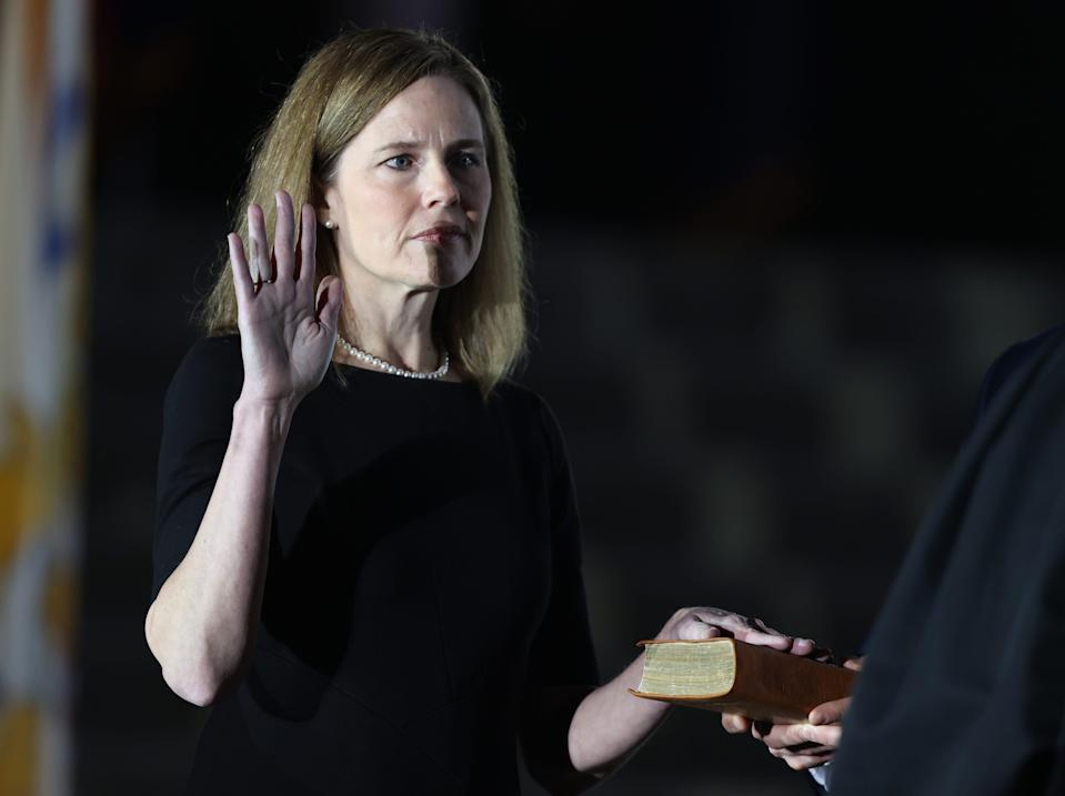 Supreme Court Associate Justice Amy Coney Barrett is sworn in by Supreme Court Associate Justice Clarence Thomas during a ceremonial swearing-in event on the South Lawn of the White House October 26, 2020, in Washington, D.C.