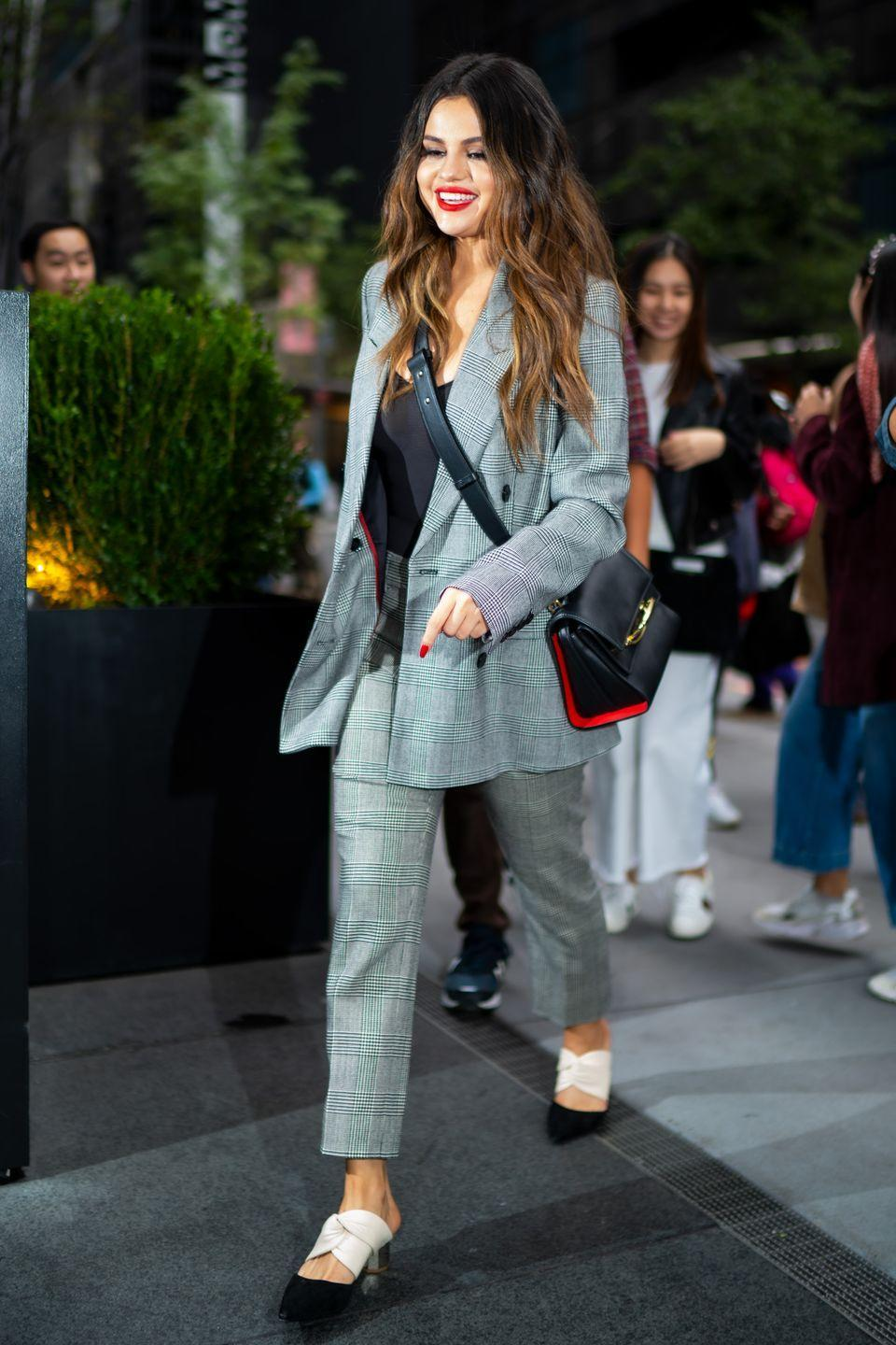 "<p>Seen walking through midtown Manhattan in a Frame suit while carrying the <a href=""https://www.elle.com/fashion/shopping/a30122002/alexander-mcqueen-story-bag/"" rel=""nofollow noopener"" target=""_blank"" data-ylk=""slk:popular 'Story' bag"" class=""link rapid-noclick-resp"">popular 'Story' bag</a> by Alexander McQueen.</p>"
