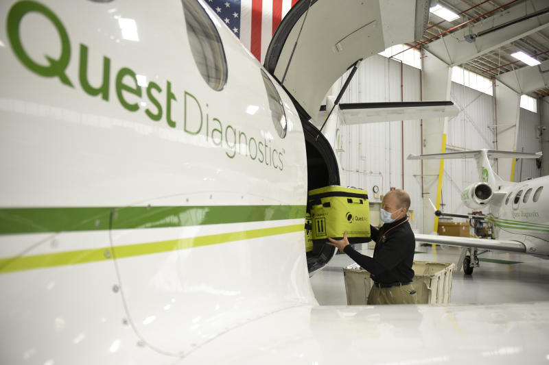 Bern Township, PA - April 24: Scott Borton, national air logistics manager, loads samples into a plane at the Quest Diagnostics hangar at the Reading Airport on Friday, April 24, 2020. Most of the specimens they are transporting for testing are cornavirus / COVID-19 tests. (Photo by Lauren A. Little/MediaNews Group/Reading Eagle via Getty Images)