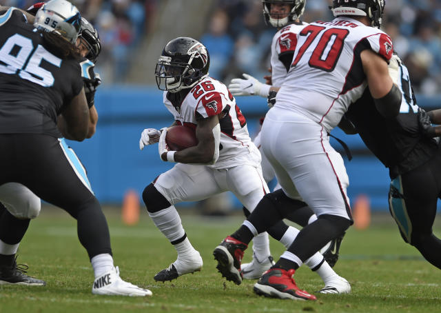 Atlanta Falcons' Tevin Coleman (26) runs against the Carolina Panthers during the first half of an NFL football game in Charlotte, N.C., Sunday, Dec. 23, 2018. (AP Photo/Mike McCarn)