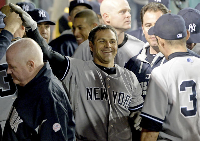 New York Yankees' Brian Roberts is greeted in the dugout after hitting a solo home run in the ninth inning of a baseball game against the Los Angeles Angels in Anaheim, Calif., Tuesday, May 6, 2014. Yankees won 4-3. (AP Photo/Jayne Kamin-Oncea)