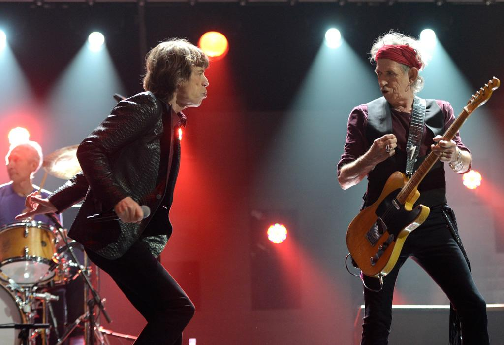 """NEW YORK, NY - DECEMBER 12:  Mick Jagger and Keith Richards of The Rolling Stones perform at """"12-12-12"""" a concert benefiting The Robin Hood Relief Fund to aid the victims of Hurricane Sandy presented by Clear Channel Media & Entertainment, The Madison Square Garden Company and The Weinstein Company at Madison Square Garden on December 12, 2012 in New York City.  (Photo by Kevin Mazur/WireImage for Clear Channel)"""