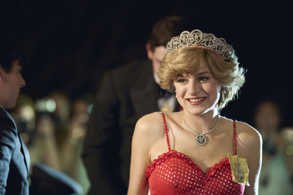 Emma Corrin wearing a pink dress and tiara as Diana Princess of Wales while filming The Crown season four on location in Malaga, Spain