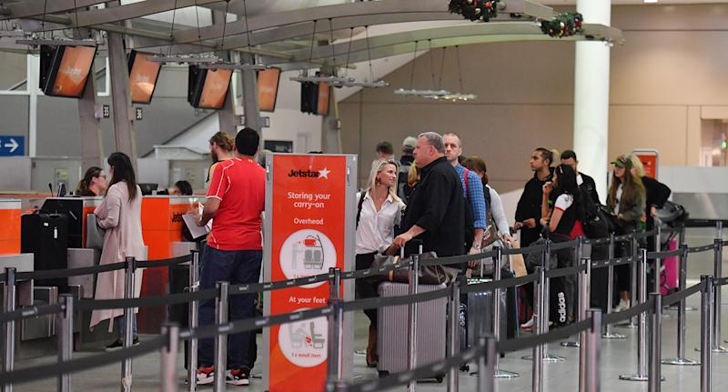Jetstar pilots are preparing to undertake four-hour work stoppages on Sunday. Pictured is a stock image of the airline's passengers at the check-in counter in Sydney.