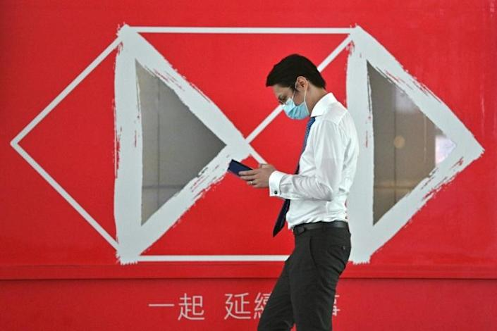 HSBC has become the canary in the coalmine with regards the new Hong Kong law, and analysts warn companies might have to eventually choose between the city or the United States (AFP Photo/Anthony WALLACE)