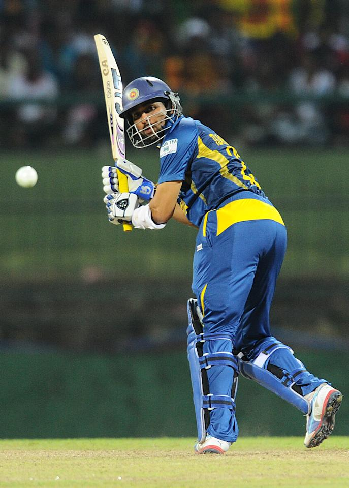 Sri Lankan cricketer Tillakaratne Dilshan plays a shot during the fourth One Day International (ODI) cricket match between Sri Lanka and South Africa at the Pallekele International Cricket Stadium in Pallekele on July 28, 2013. AFP PHOTO/ Ishara S.KODIKARA