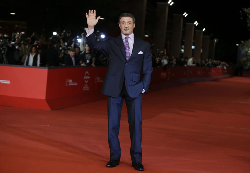 """Actor Sylvester Stallone poses as he arrives for the screening of the movie """"Bullet to the Head"""" at the 7th edition of the Rome International Film Festival in Rome, Wednesday, Nov. 14, 2012. (AP Photo/Andrew Medichini)"""