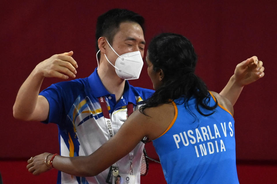 India's P. V. Sindhu (R) celebrates with a coach after beating China's He Bingjiao in their women's singles badminton bronze medal match during the Tokyo 2020 Olympic Games at the Musashino Forest Sports Plaza in Tokyo on August 1, 2021. (Photo by Alexander NEMENOV / AFP) (Photo by ALEXANDER NEMENOV/AFP via Getty Images)