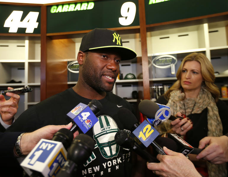 New York Jets quarterback David Garrard, left, talks to reporters during a locker room availability at the team's NFL practice practice facility in Florham Park, N.J., Thursday, May 2, 2013. The Jets may have cut Tim Tebow but their situation at quarterback is far from settled. New general manager John Idzik says Gerrard, Mark Sanchez, Greg McElroy, Matt Simms and second-round draft pick Geno Smith are all candidates to be the starter. (AP Photo/Rich Schultz)