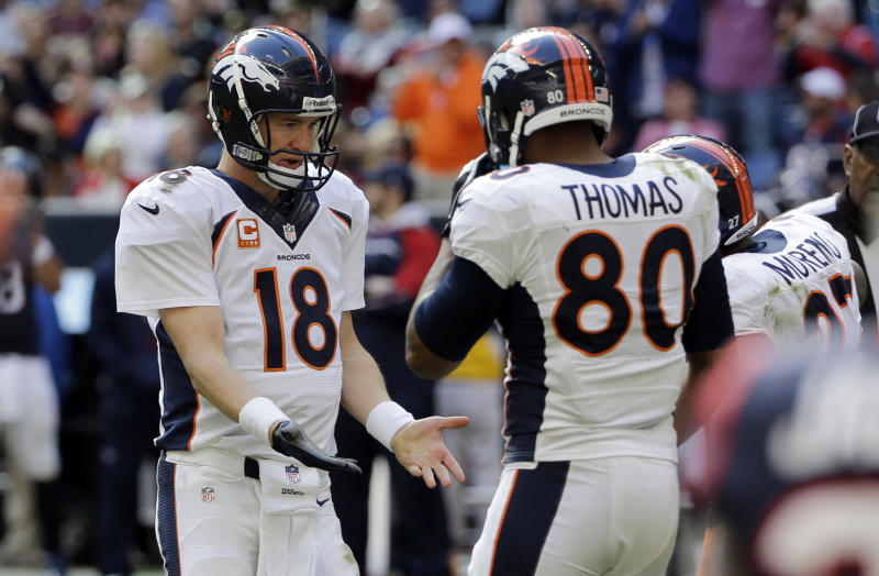 Denver Broncos' Peyton Manning (18) celebrates with Julius Thomas (80) and other teammates after throwing a pass for a touchdown against the Houston Texans during the third quarter of an NFL football game on Sunday, Dec. 22, 2013, in Houston. (AP Photo/David J. Phillip)