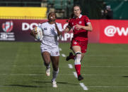Jaz Gray, left, of the United States, runs for a try as Canada's Emma Chown chases during an HSBC Canada Sevens semifinal rugby match in Edmonton, Alberta, Sunday, Sept. 26, 2021. (Jason Franson/The Canadian Press via AP)